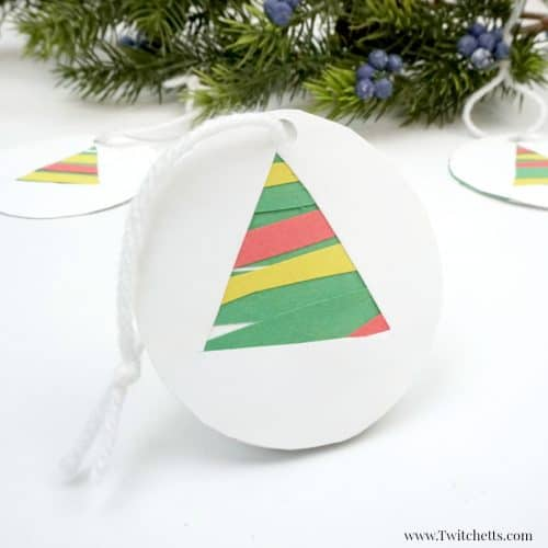 this easy paper christmas tree ornament is a fun paper cutting craft for those preschoolers who
