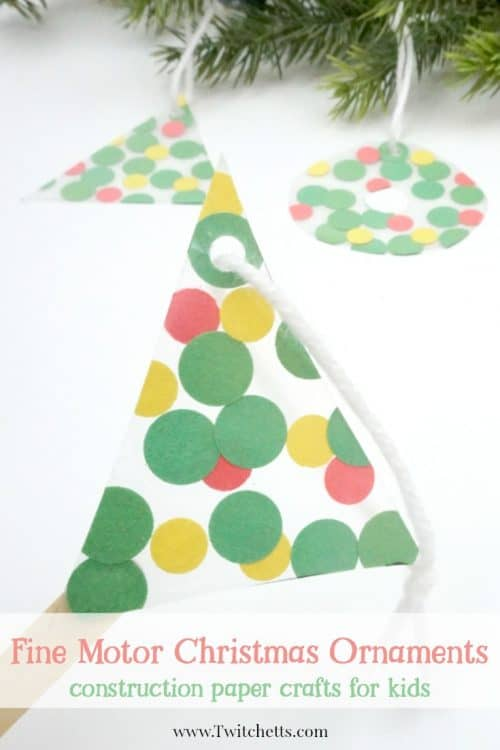 This fun suncatcher Christmas ornament uses inexpensive construction paper to create a suncatcher that can be given as a gift or hung on your tree. #finemotor #christmasornaments #suncatcher #nomess #easyornaments #preschool #toddler #classroom #twitchetts