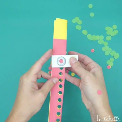 This fun fine motor Christmas ornament uses inexpensive construction paper to create a suncatcher that can be given as a gift or hung on your tree.
