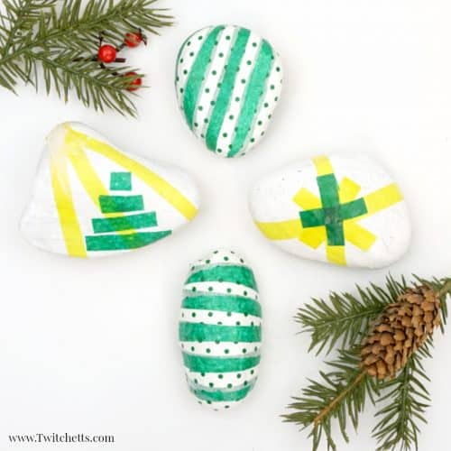 Create these beautiful tissue paper Christmas rocks to give as fun DIY holiday gifts or to hide around your neighborhood! #christmasrockpainting #tissuepaper #rocks #stonepainting #rockpaintingforkids #tutorial #kidmadegifts #stockingstuffer #holiday #twitchetts