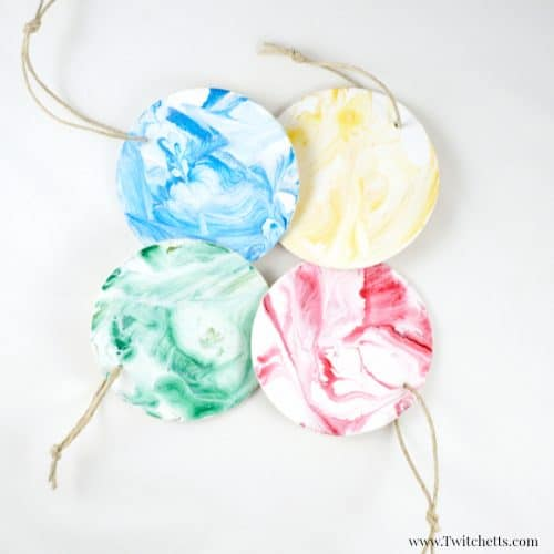 These colorful Christmas ornaments are so beautiful and the creative painting method of string painting is fun for kids of all ages!