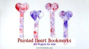 Painted heart bookmarks are perfect non-candy gifts to give this Valentine's Day. Using a fun creative painting art method, you're kids will be so proud to pass these out!