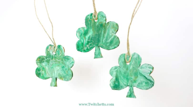 Create a beautiful pour painted shamrock. This one of a kind St Patrick's Day art project will make a fun decoration!