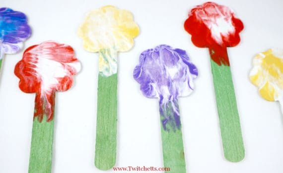 These press painted flowers are an amazing creative painting idea that will create abeautiful, one of a kind, art projects that your child will be proud of.