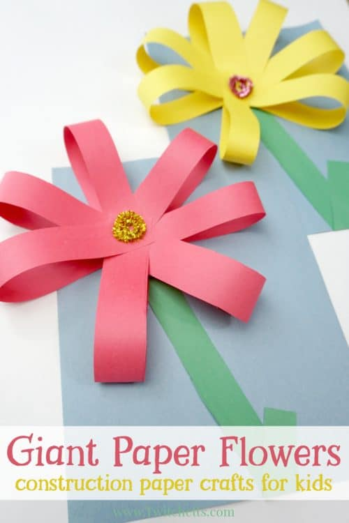 Create giant paper flowers with simple supplies and fine motor skills. Your kids will be proud of this fun construction paper craft! #giantpaperflowers #constructionpaperflowers #papercraftflowers #giantflowers #largecrafts #constructionpapercraftsforkids #finemotorskills #preschoolcrafts #springcrafts #twitchetts