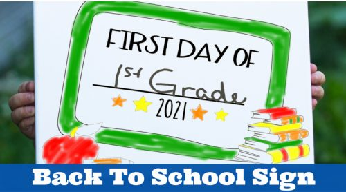 """Boy holding a sign. Sign reads """"first day of 1st grade 2021"""""""
