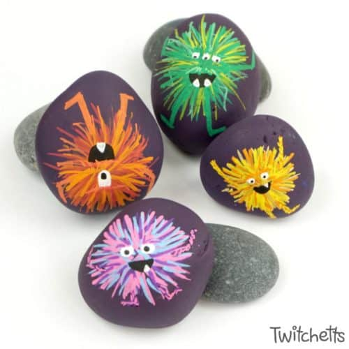 Make these adorable monster rocks with your kids and some simple rock painting supplies! They are perfect for an afternoon of crafting or a fun Halloween craft. #monsterrocks #rockpaintingideasforkids #halloween #monsters #rocks #stones #poscapaintpens #twitchetts