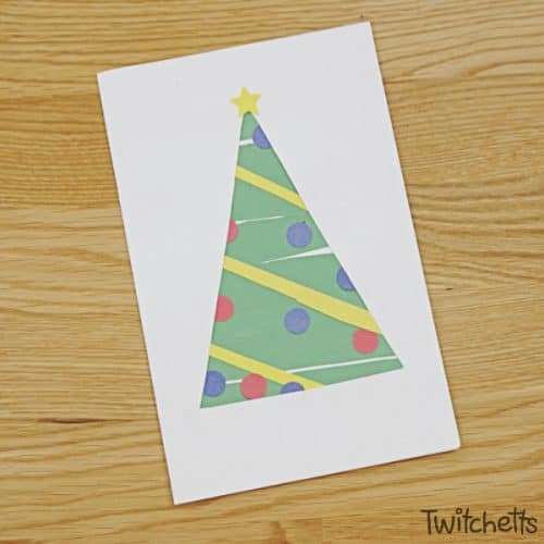Build your little one's scissor skills while creating an easy, yet adorable, paper Christmas tree. Your preschoolers will LOVE this craft and they will be super proud that they were able to create it on their own. #christmastree #papertree #christmascrafts #holidaycrafts #preschoolchristmas #scissorpractice #cuttingskills #twitchetts