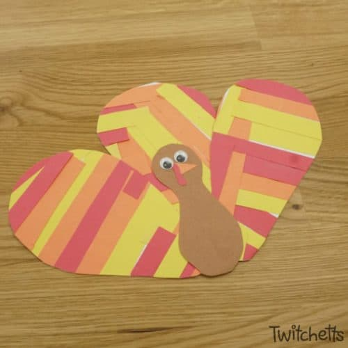 Let your little one work on theirscissor skills while creating an adorable Thanksgiving turkey craft! This Thanksgiving craft for kids is easy to set up and takes very little instruction from adults. #turkey #thanksgiving #constructionpaper #paperturkey #scissorpractice #fall #craftsforkids #twitchetts