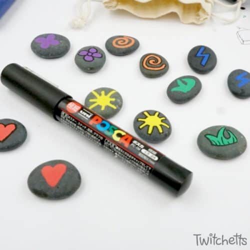Learn how to make fun memory games out of rocks. They are a travel-ready boredom buster that's kid approved! #memorygame #rocpaintingideas #rockgame #howtomaketravelmemory #travelmemory #rockpaintingideas #giftsfrompaintedrocks #kidsactivities #twitchetts
