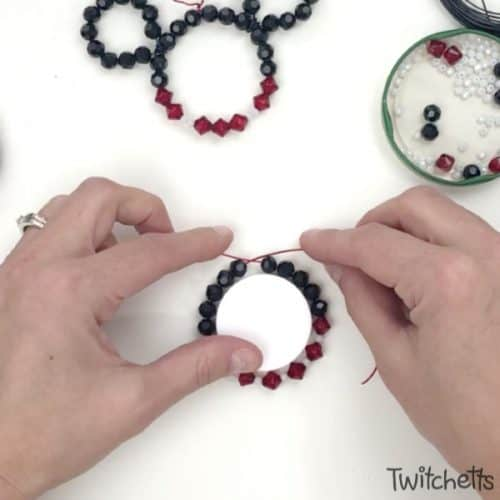 Create fun Mickey and Minnie Christmas ornaments with beads and wire. They will twinkle on the Christmas tree and are fun ornaments that kids can create.