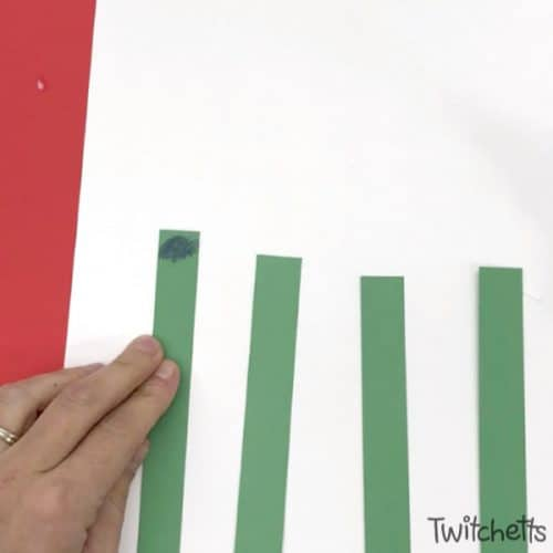 This fun looped paper Christmas tree is a fun paper craft for kids of all ages. Make them with your classroom or at a holiday party. This Christmas craft is sure to wow! #paper #christmastree #craftforkids #christmascraft #3dpapercraft #constructionpaper #easycraft #classroomcraft #kidscrafts #twitchetts
