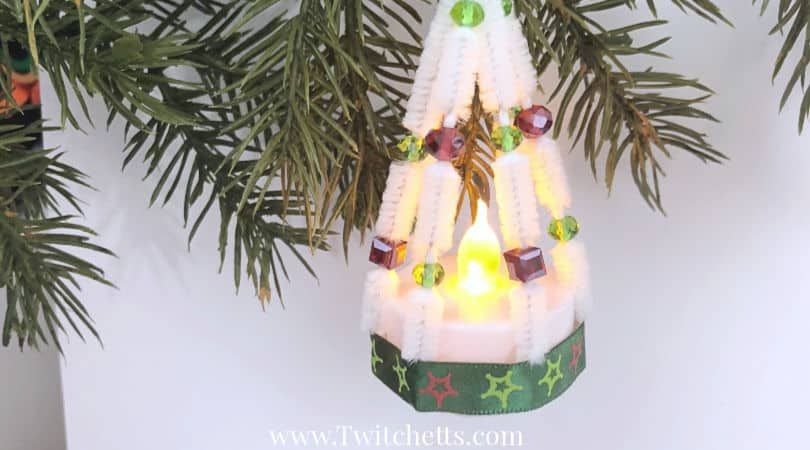 These tea light ornaments are fun for kids to make and look amazing. Create Christmas tree shaped ornaments with tea lights and pipe cleaners. #tealight #chirstmasornament #christmastreeshapedornament #pipecleaner #craftsforkids #Twitchetts