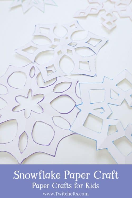 Make asix-sided snowflake paper craft with inked edges. They are perfect for winter decorating,classroom craft projects, or creating winter cards. The inked edges make the white paper pop! #snowflake #sixsided #papersnowflake #howtocutasnowflake #wintercraft #classroomcraft #classroomdecor #winterdecor #twitchetts