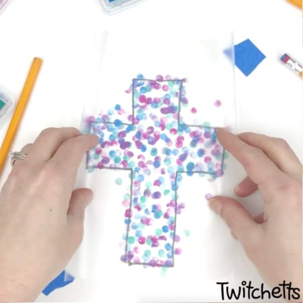 This cross suncatcher craft is perfect for your VBS or Sunday school class. With simple supplies and and a little imagination, your kids will create a colorful religious craft. #twitchetts