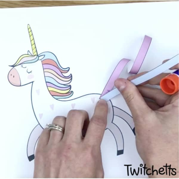 Create a uniquepaper unicorn with an adorable curly tail. This fun unicorn craft is perfect for birthday parties or just an afternoon of creating with your kids. #twitchetts