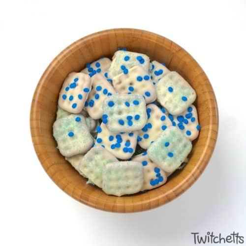 Make blue snacks for preschool by dipping pretzels in white chocolate and then sprinkling them with blue sprinkles.
