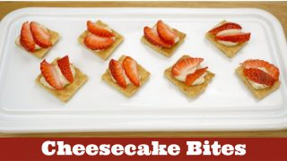 Image of cheesecake bites topped with strawberries. Text reads