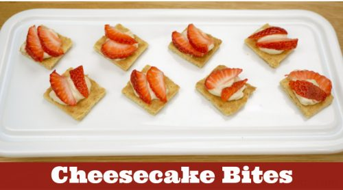 """Image of cheesecake bites topped with strawberries. Text reads """"Cheesecake Bites"""""""