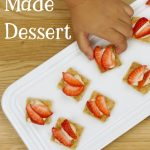 """Image of cheesecake bites topped with strawberries. Text reads """"Toddler Made Dessert"""""""