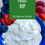 """Bowl of Creamy Dip with fruit and cookies next to it. Text Reads """"Cheesecake Fruit Dip"""""""