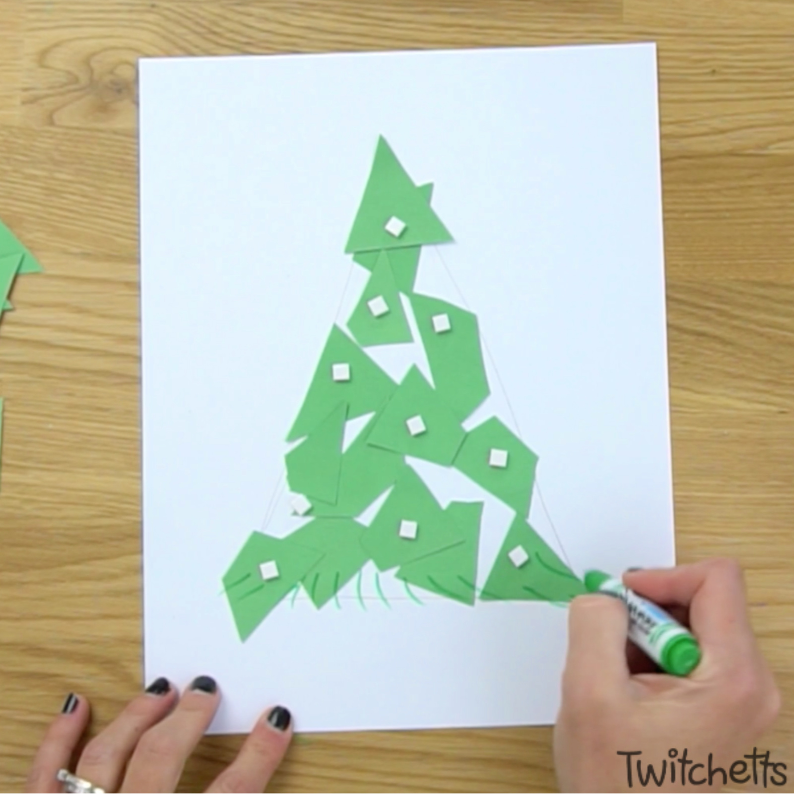 In process image of a 3D paper Christmas tree that uses spacers.